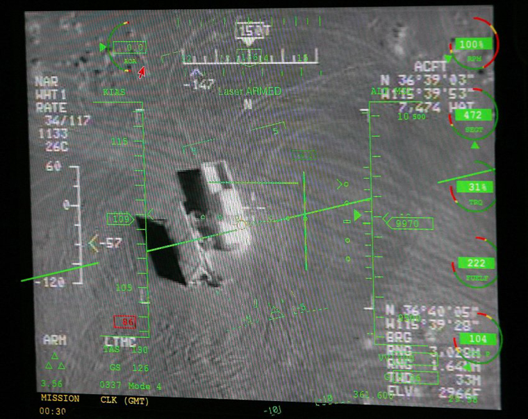 "CREECH AIR FORCE BASE, NV - AUGUST 08: A pilot's heads up display in a ground control station shows a truck from the view of a camera on an MQ-9 Reaper during a training mission August 8, 2007 at Creech Air Force Base in Indian Springs, Nevada. The Reaper is the Air Force's first ""hunter-killer"" unmanned aerial vehicle (UAV) and is designed to engage time-sensitive targets on the battlefield as well as provide intelligence and surveillance. The jet-fighter sized Reapers are 36 feet long with 66-foot wingspans and can fly for as long as 14 hours fully loaded with laser-guided bombs and air-to-ground missiles. They can fly twice as fast and high as the smaller MQ-1 Predators reaching speeds of 300 mph at an altitude of up to 50,000 feet. The aircraft are flown by a pilot and a sensor operator from ground control stations. The Reapers are expected to be used in combat operations by the United States military in Afghanistan and Iraq within the next year. (Photo by Ethan Miller/Getty Images)"